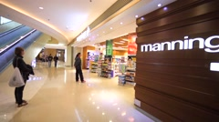 Mannings store of cosmetics in Hong Kong mall. Stock Footage