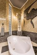 Marvellous stone bathroom resembling baths of Far East - stock photo