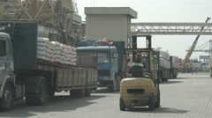 Forklift Unloads Lorry Truck In The Port - stock footage