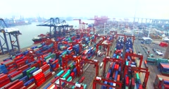 Flying backwards above a lot of cargo containers in port of Hong Kong Stock Footage