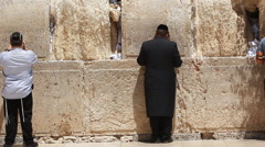Jerusalem man pray in the kotel western wall  Stock Footage