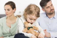Trouble of parents affect on mood of child - stock photo