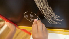 Little girl draws on easel - stock footage