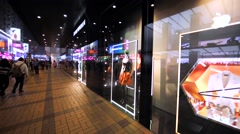 Emporio Armani showwindows in night Hong Kong. Stock Footage