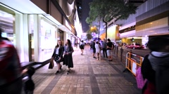 Walking on the night streets of Hong Kong Stock Footage