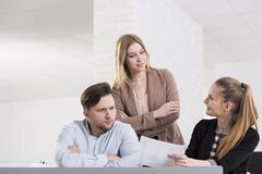 Getting the advice from workmates Stock Photos