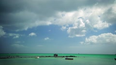 Wide shot of pier in turquoise ocean and big sky Stock Footage