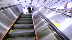Ascending on an escalator at the Hong Kong subway. Stock Footage
