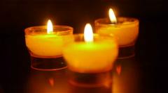 Candles in abbey at St Guilhem le Desert, Cevennes France Stock Footage