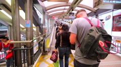 People ascending on the Central–Mid-Levels escalator Stock Footage