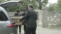 Pallbearers in Hearse arriving with coffin at graveyard Stock Footage