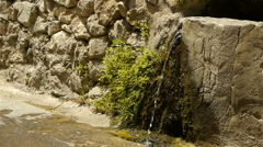 Historic wall and pure water at St Guilhem le Desert, Cevennes France - stock footage