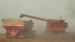 Case IH - Rear View of Combine and Grain Cart Stock Footage