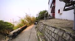 Walking path on the Victoria Peak in Hong Kong Stock Footage