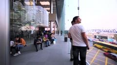 Walking along the big window in Apple store. Stock Footage