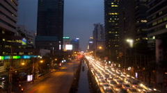 4K: Day to night city traffic in Bangkok, Thailand , time lapse Stock Footage