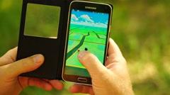 Samara, Russian man playing pokemon go on his smartphone - stock footage