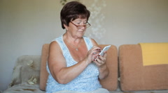 Senior Woman Using Smart Phone At Home Arkistovideo