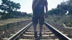 Railroad countryside man walk throw pebbles audio Stock Footage