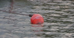 Floating red buoy. Stock Footage