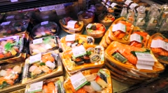 Fresh seafood packaged in plastic containers Stock Footage