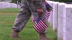 Arlington National Cemetery - Soldier placing flag at grave site Stock Footage