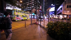 People using pedestrian crossing to cross the road. Night Hong Kong. Stock Footage