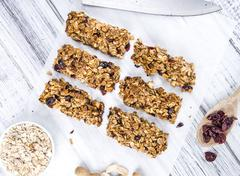 Homemade Granola Bars with Peanuts and Cranberries (selective focus) - stock photo
