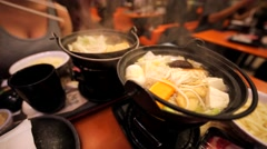 Boiling chinese traditional meal Stock Footage