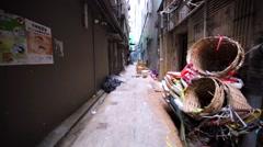 Walking along the empty alley between buildings full of dirt, garbage Stock Footage