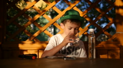 Boy drinking tequila and shoots a gun, gangster, bandit Stock Footage