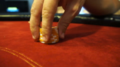 Male hand shaffling poker chips. Nerves in gambling - stock footage