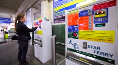 Buying the Hong Kong Ferry ticket using special tickets machine. Stock Footage