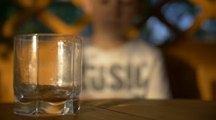 Boy poured a drink, boy drinking beverage, slow motion Arkistovideo