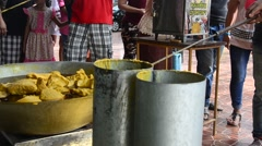 Thai people join melting cast candle offer to temple Stock Footage