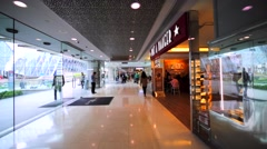 Walking along the corridor of big modern shopping mall in Hong Kong. Stock Footage