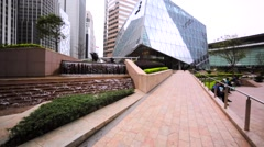 View of the walking people on the street among high modern buildings Stock Footage