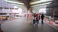 People going along the beautiful pedestrian underpass in the center of Hong Kong Stock Footage