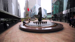 Beautiful fountain with strange black modern statue in the middle. Stock Footage