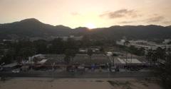 Sunrise Behind Hills in Karon Beach Phuket Ascending Aerial Footage Stock Footage