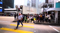 People leave tramway and then cross the road using pedestrian zebra. Stock Footage