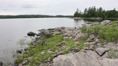 Rocks, Water and Island Stock Footage