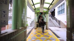 Central–Mid-Levels escalator and walkway system in Hong Kong. Stock Footage