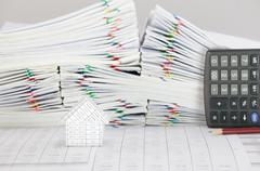 House have blur brown pencil with calculator place vertical Stock Photos