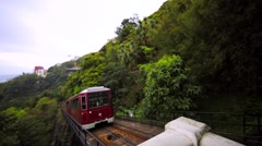 Hong Kong Peak Tram and a photographer that takes photo of just-merried couple. Stock Footage