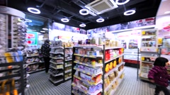 Interior view of the grocery store in Hong Kong and a queue at the checkout. Stock Footage