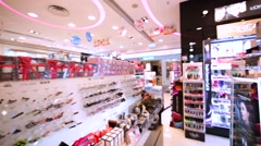Interior view of the cosmetics shop and female goods in Hong Kong Stock Footage