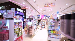 Walking along between shelves with female goods and cosmetics Stock Footage