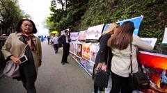 Artists sell paintings on the Victoria Peak Stock Footage