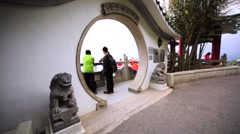 Tourists enjoying a view of Hong Kong from the skydeck of the Victoria Peak Stock Footage